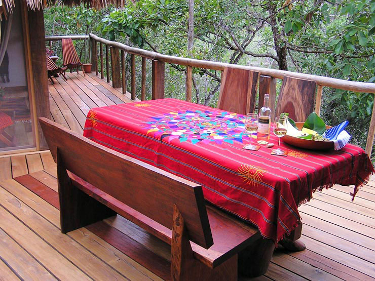 Handcrafted picnic table, bench and chairs for dinners overlooking the river