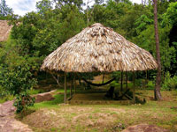 Palapa overlooking the river with two shaded hammocks