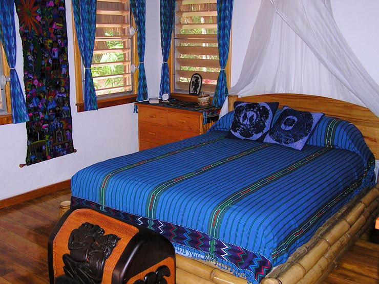 Bedroom furnished with queen sized bamboo bed and mayan weavings